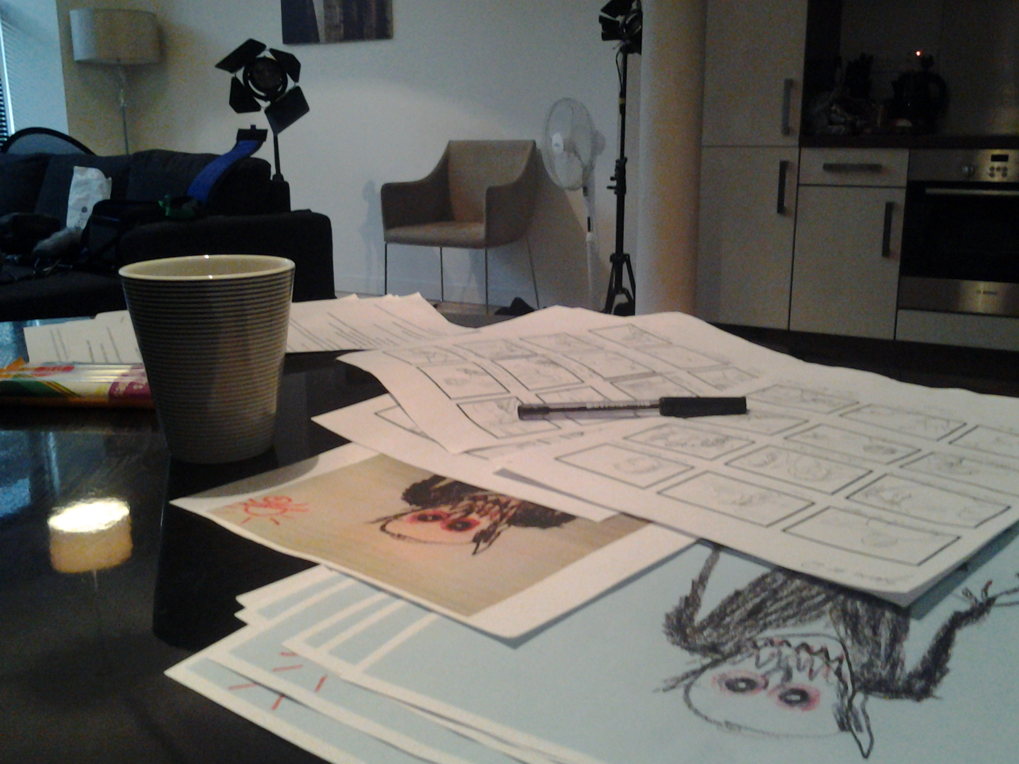 Storyboard, script and drawings on a table.